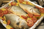 Fish and potatoes,baked fish with tomatoes
