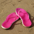 Pink flip flop on the beach