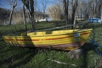 Yellow boat ashore on grass