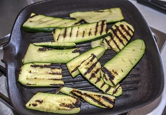 Grilled zucchini on grill