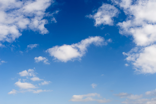 light_blue_sky_with_clouds.jpg